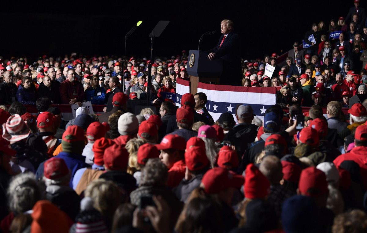 President Donald Trump speaks at a rally at Central Wisconsin Airport in Mosinee, Wis., Wednesday, Oct. 24, 2018. (AP Photo/Susan Walsh)