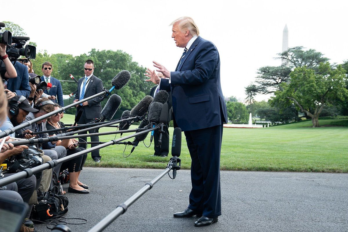 President Donald J. Trump talks with reporters along the South Lawn of the White House Friday, July 19, 2019, prior to boarding Marine One to begin his weekend trip to Bedminster, N.J. (Official White House Photo by Shealah Craighead)