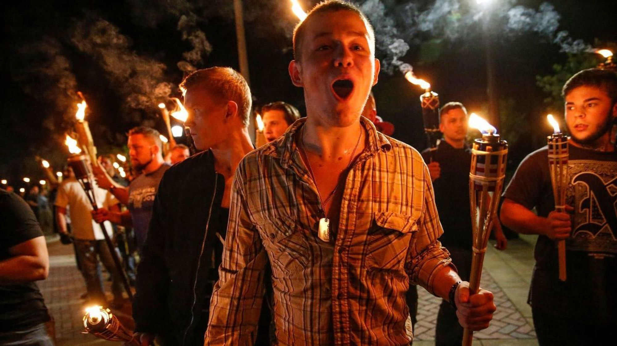 White supremacists march with torches through the UVA campus in Charlottesville, VA- Friday, Aug. 11, 2017 (Mykal McEldowney/The Indianapolis Star via AP)