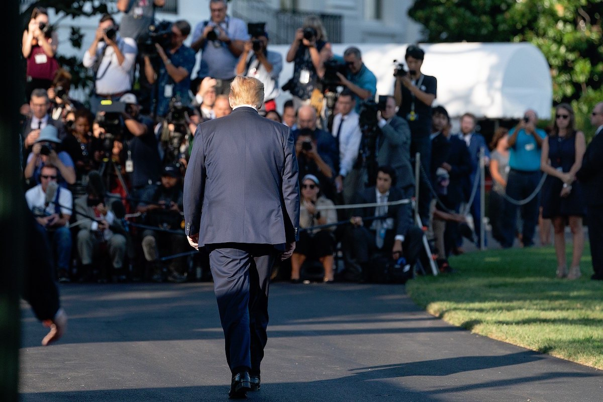 President Donald Trump walks from the Oval Office to talk to members of the press on the South Lawn of the White House Friday, Aug. 30, 2019, prior to boarding Marine One to begin his trip to Camp David near Thurmont, Md. (Official White House Photo by Joyce N. Boghosian)