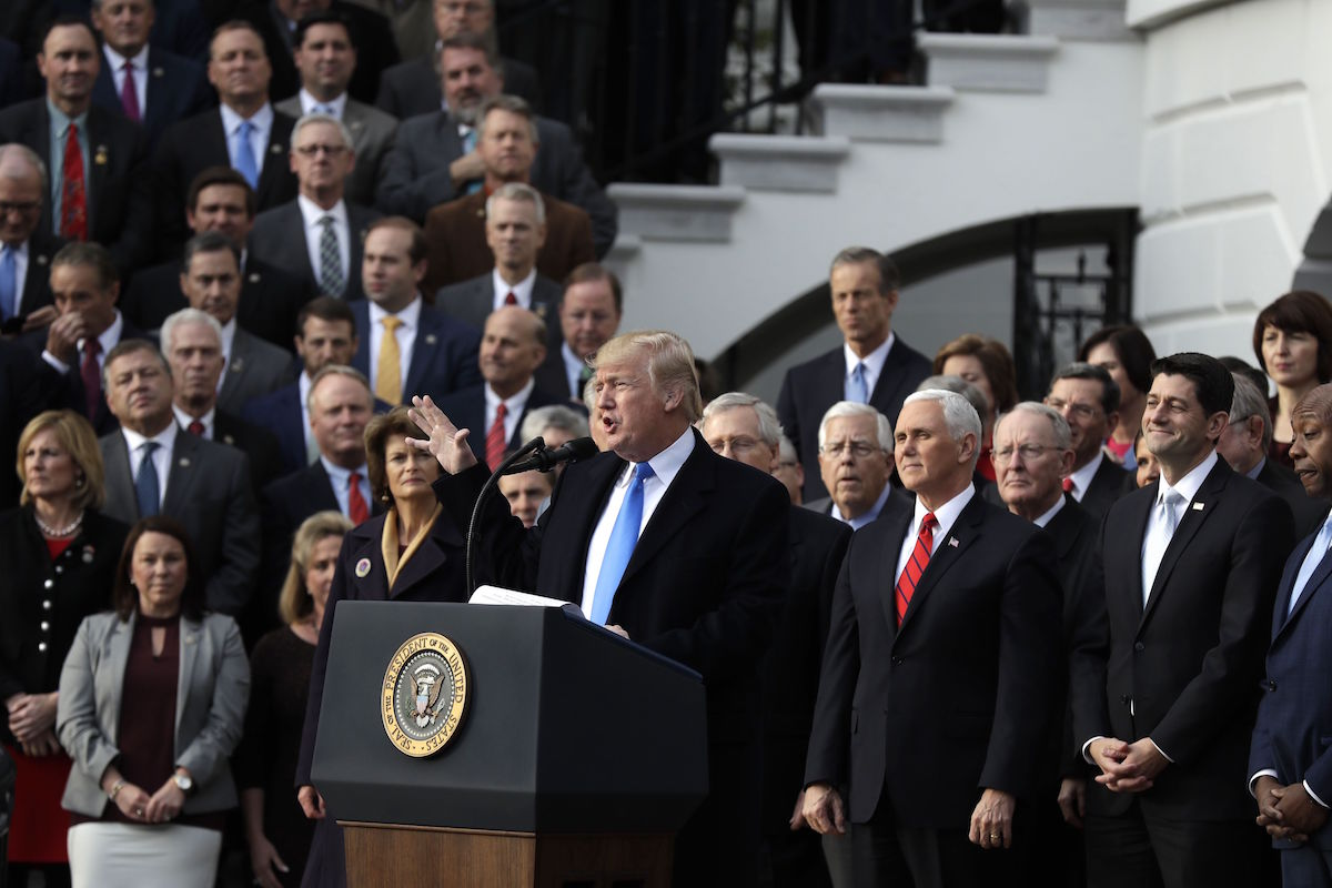 """President Donald Trump speaks during an event after the passage of the """"Tax Cut and Jobs Act Bill"""" on the South Lawn of the White House, Wednesday, Dec. 20, 2017, in Washington. (AP Photo/Evan Vucci)"""