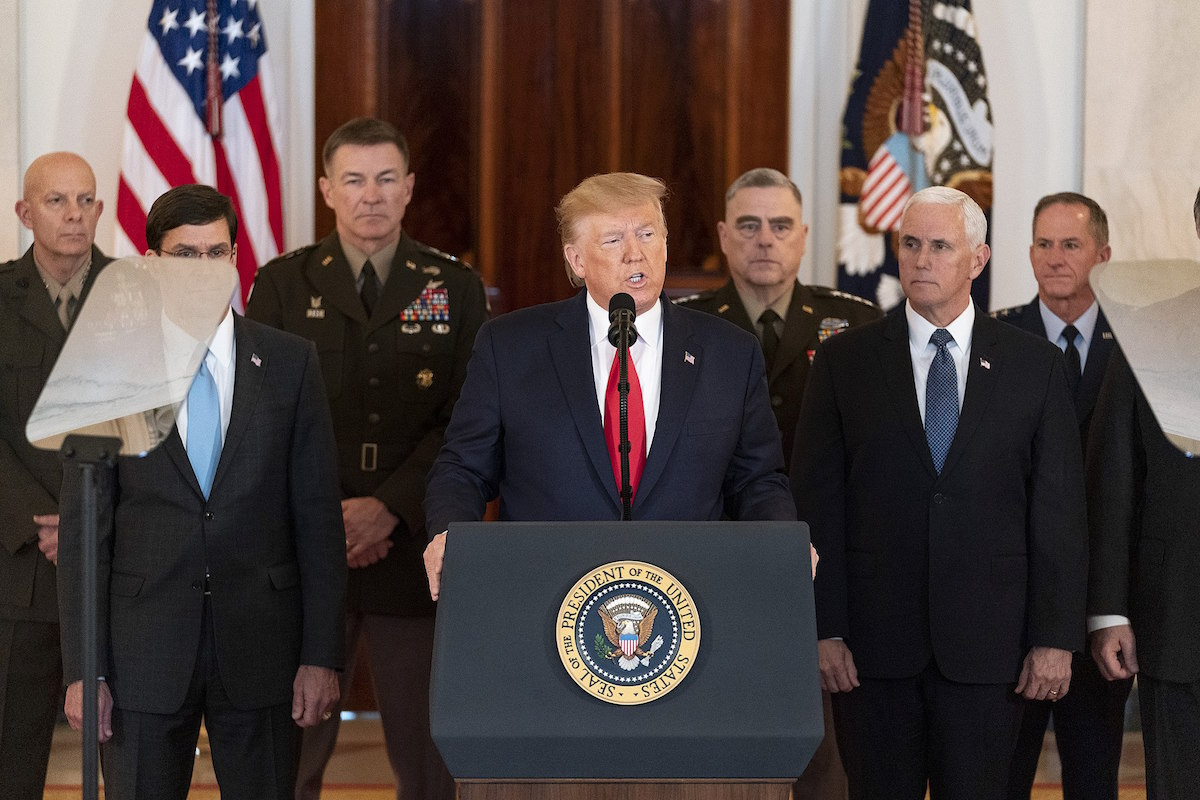 President Donald J. Trump, joined by Vice President Mike Pence, senior White House advisors and senior military personnel, delivers remarks during a national televised address Wednesday, Jan. 8, 2020, from the Cross Hall of the White House. (Official White House Photo by Shealah Craighead)