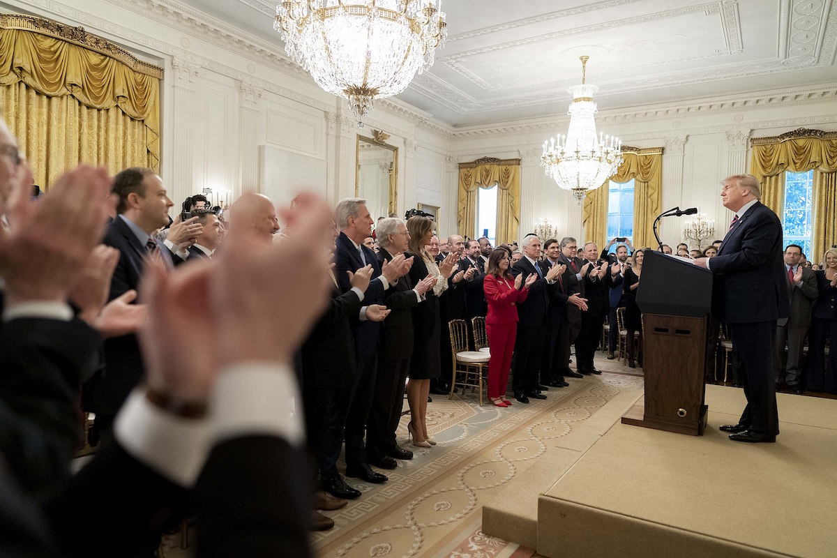 President Donald J. Trump receives a standing ovation as he arrives to deliver remarks to the nation in response to his acquittal in the United States Senate impeachment trial Thursday, Feb. 6, 2020, in the East Room of the White House. (Official White House Photo by D. Myles Cullen)
