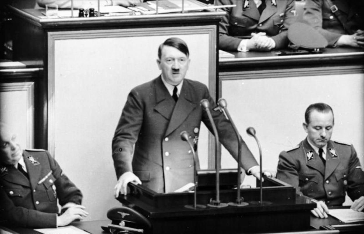 Berlin.- Adolf Hitler speaks at the Reichstag session in the Kroll Opera after the end of the Balkan campaign (Bundesarchiv, Bild 101I-808-1238-05/Creative Commons)