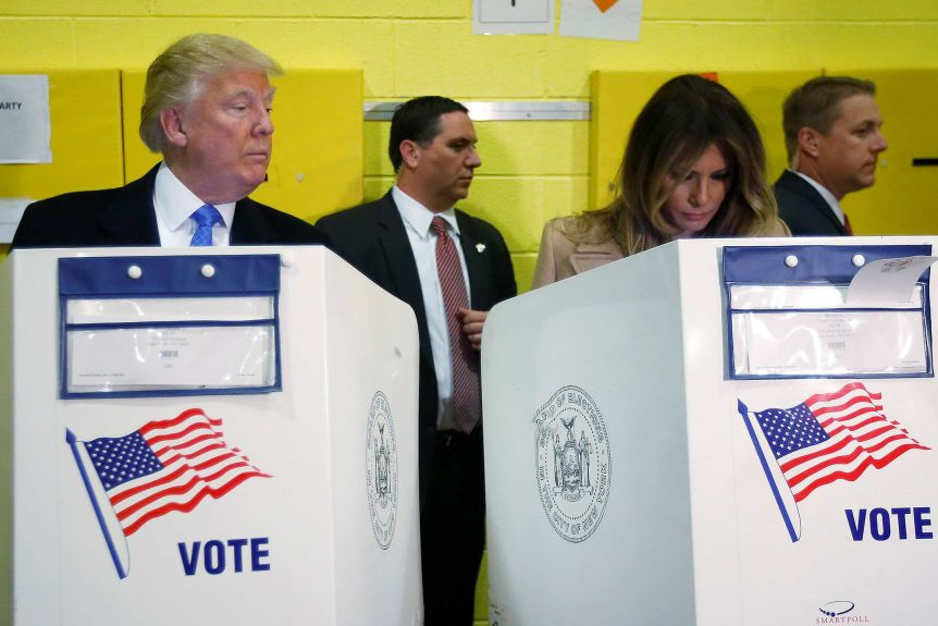 Donald Trump and Melania Trump voting. (Reuters: Carlo Allegri)