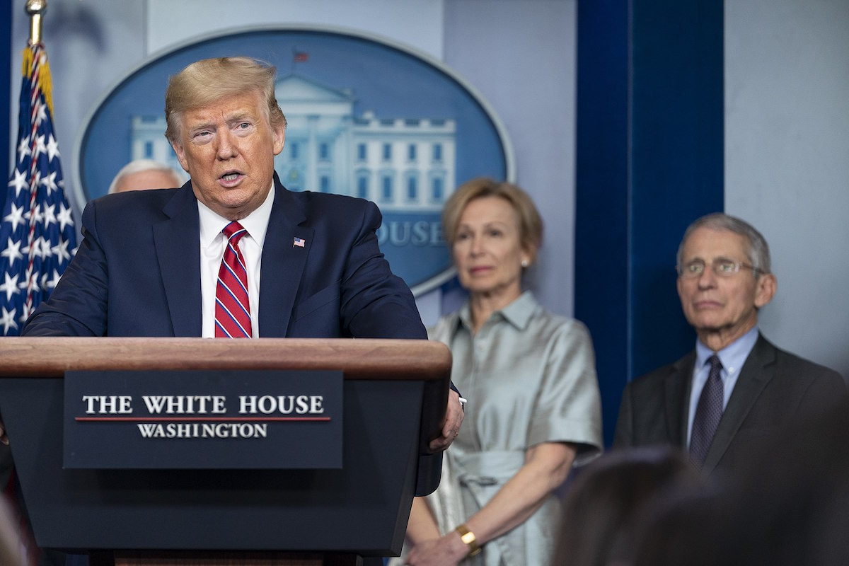 President Donald J. Trump delivers remarks at a coronavirus (COVID-19) press briefing as Dr. Deborah Birx and Dr. Anthony Fauci watch on Friday, March 20, 2020, in the James S. Brady Press Briefing Room of the White House. (Official White House Photo by Shealah Craighead)