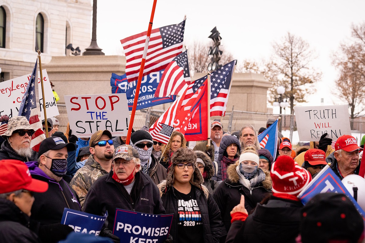 """On a day that saw Minnesota break a record high of 8,703 COVID cases, far-right conspiracy theorists, Qanon, and """"Stop The Steal"""" followers stood maskless shoulder to shoulder outside the Minnesota State Capitol – November 14, 2020. (Chad Davis/CC BY-SA 2.0)"""
