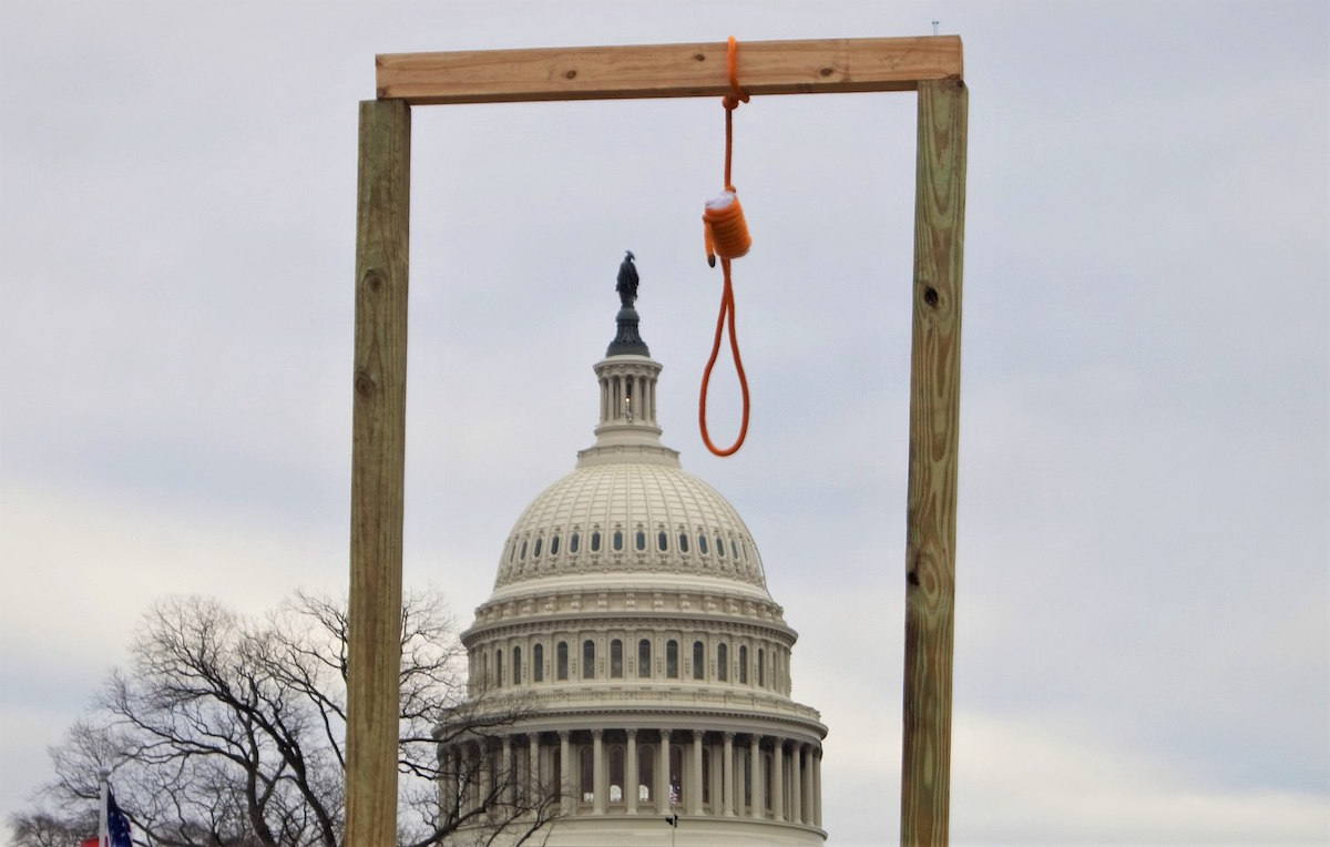 A gallows hangs near the United States Capitol during the January 6, 2021 Trump insurrection. (Tyler Merbler from USA/Creative Commons BY 2.0)