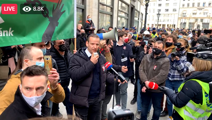 László Toroczkai speaking at the Mi Hazánk Mozgalom (Our Homeland Movement) demonstration on 15th March 2021. Image capture of Telex.hu Facebook live feed.