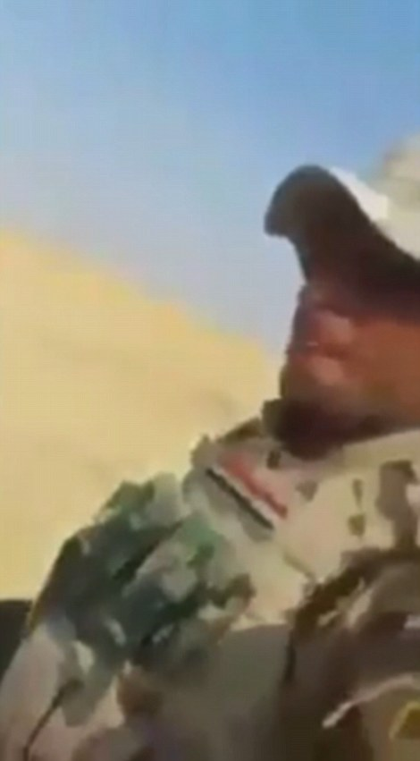ISIS fighter being dragged to his death place