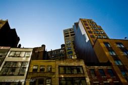 Looking upward, rooflines and buildings, Manhattan, New York, USA.