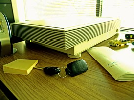 Scanner, car key and other objects on my desk.