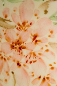 Pink flowers painted on porcelain surface, macro.