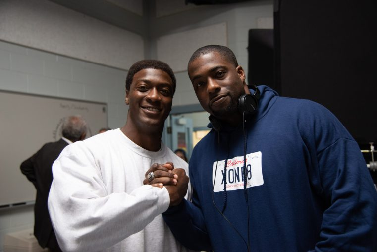 Actor Aldis Hodge (left) and the real life Brian Banks (right) on the set of Tom Shadyac's BRIAN BANKS, a Bleecker Street release. Credit: Katherine Bomboy / Bleecker Street
