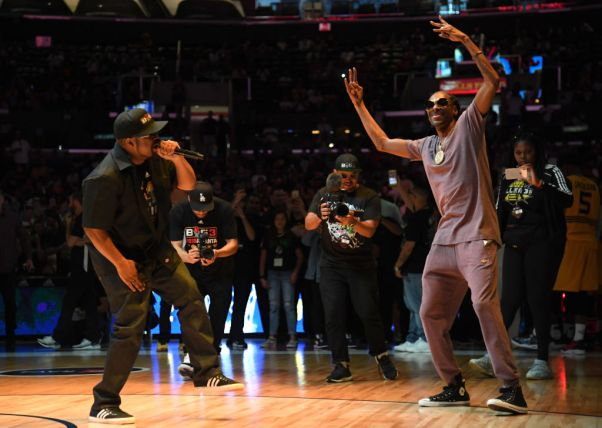LOS ANGELES, CALIFORNIA - SEPTEMBER 01: Snoop Dogg dances as Ice Cube performs between games at the BIG3 Championship at Staples Center on September 01, 2019 in Los Angeles, California. (Photo by Harry How/BIG3 via Getty Images)