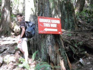 Climbing up Grouse Mountain: Vancouver's natural stairclimber. Notice the Rev3 sticker on the sign ;)
