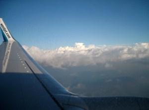 On the plane to Vancouver, enjoying my flight on WestJet.