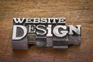 website design text in metal type