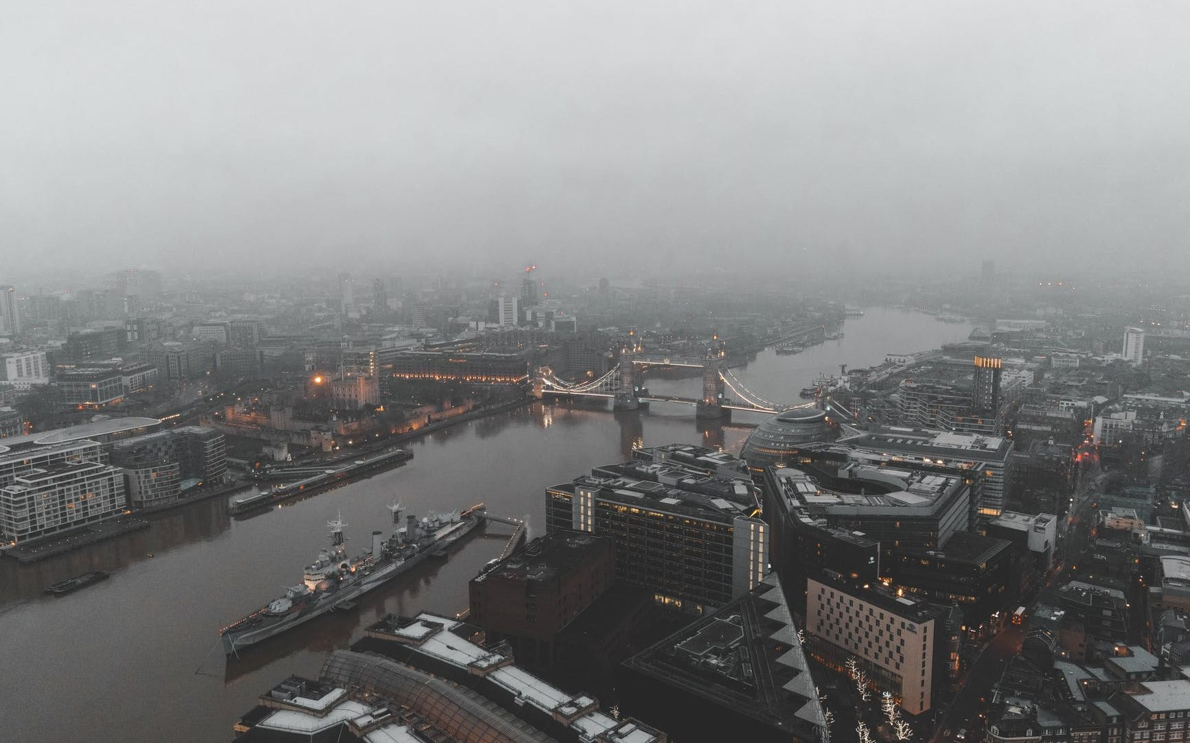 drone shot of cityscape under foggy weather