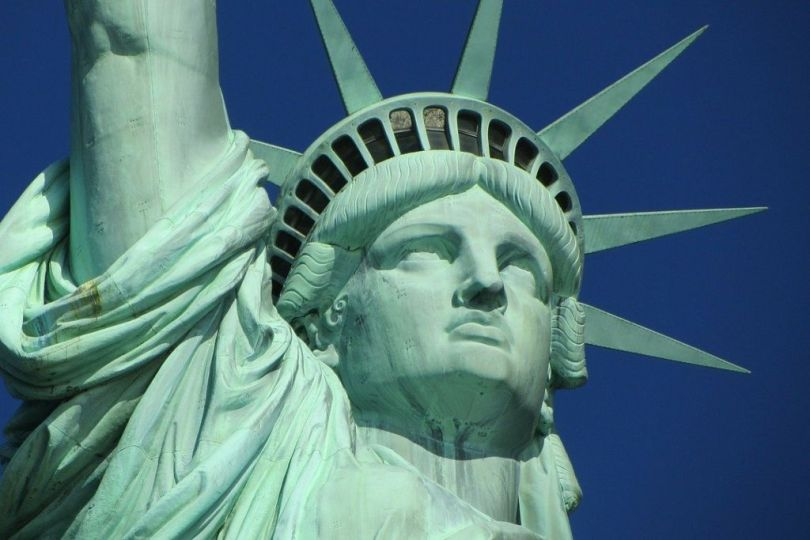 Dialects of English: A worm's eye view of the Statue of Liberty's face on a sunny day