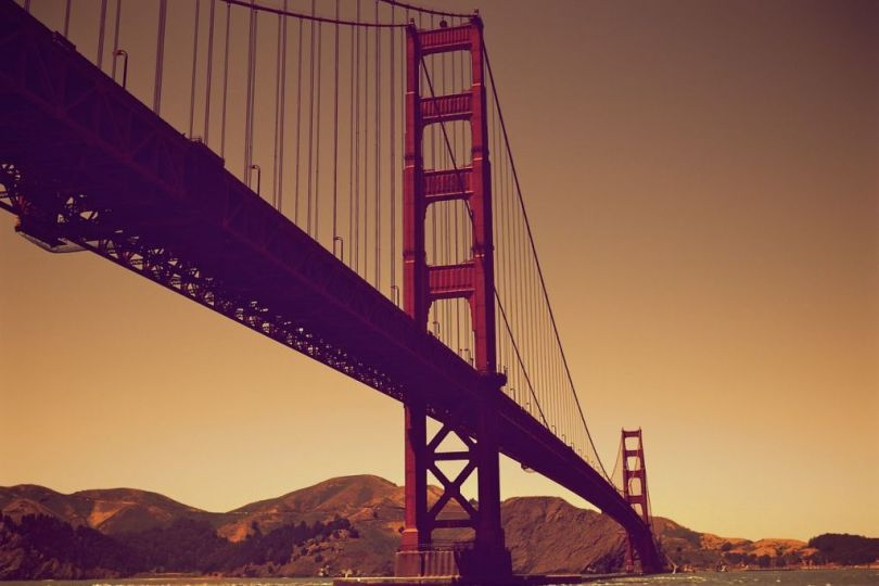 Languages of California: a worm's eye view of the Golden Gate bridge at dusk