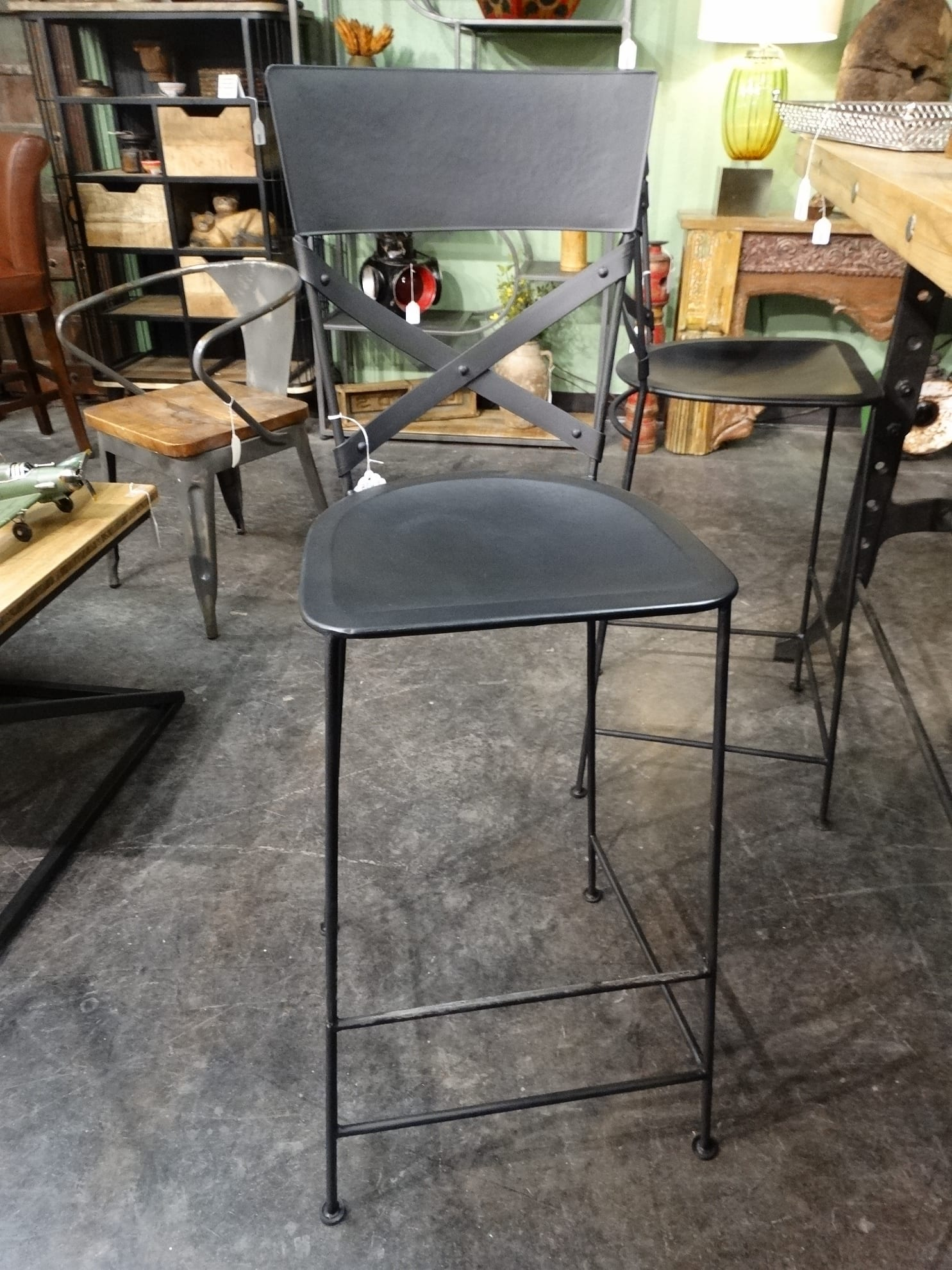 All Black Metal Bar Stool Features An X Back And A Metal Footrest