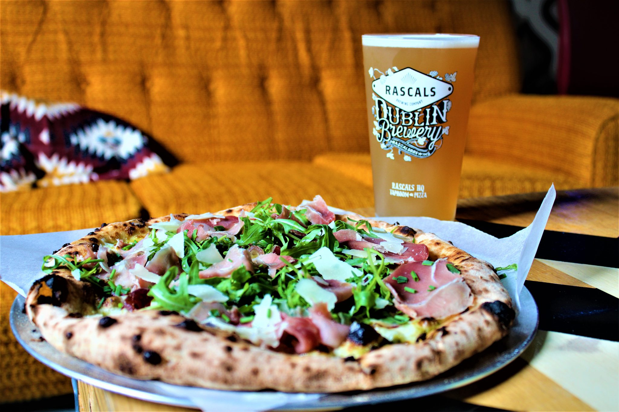 A pint of Rascals craft beer and pizza with ham rocket and parmesan, Inchicore Dublin