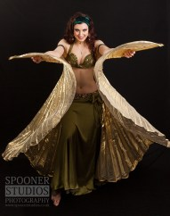 Oxford bellydancer Rasha Nour with gold Isis wings