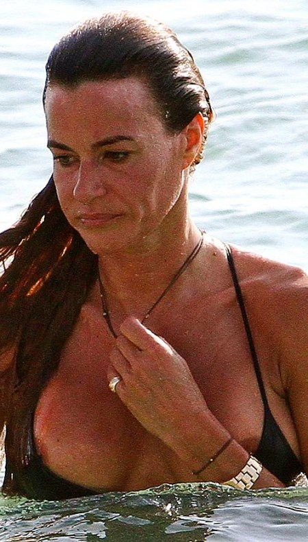 kelly-bensimon-nipples-slip-out-of-top-at-beach-6553-1