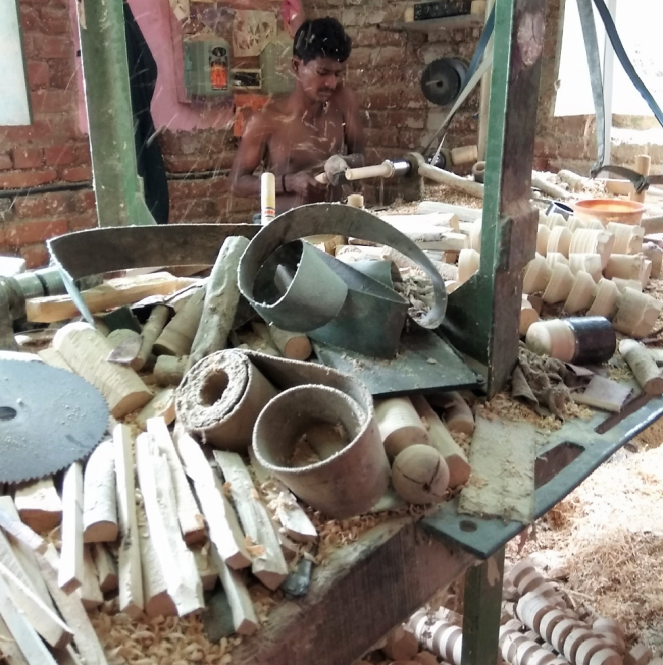 A toy worker on a lathe machine