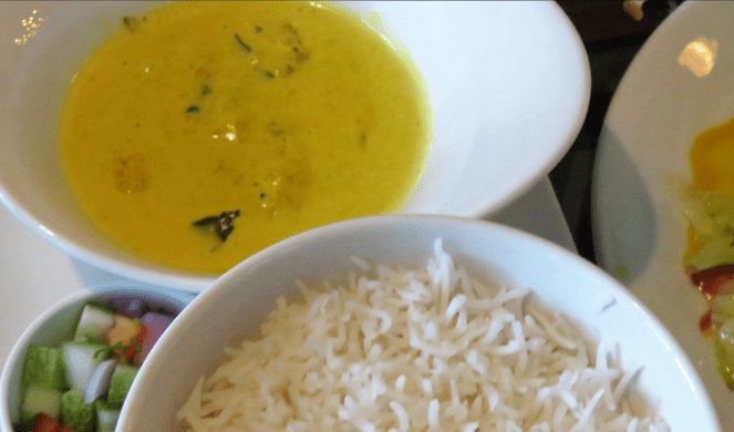 Sri Lankan pumpkin curry cooked in coconut milk (Watakka curry) with rice