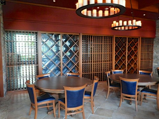 WINE RACK 5 SECTION, TOTAL DIMENSIONS ARE 26FT W X 14D X 93H, DECORATIVE WOOD, INCLUDES (1) SECTION 46W, (1) SECTION 68W, (1) SECTION 70W, (1) SECTION 68W, (1) SECTION 46W,