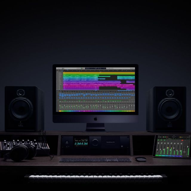 Logic website image. Photo of studio desk with logic pro on screen.
