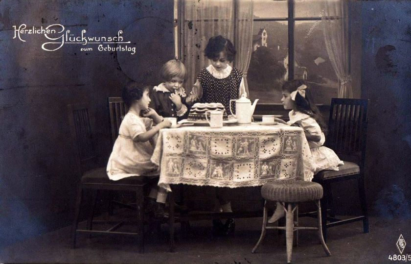 Girls_with_birthday_cake._Postcard_from_1920