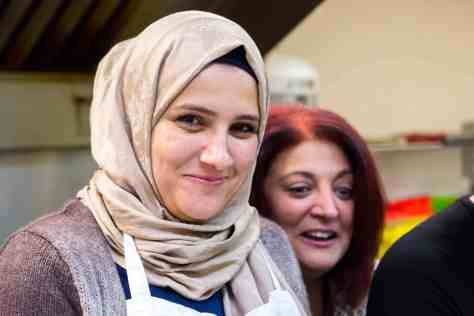 On the right, Sonia Habashy, community facilitator with EMCN, laughs with Tahany (left), who emigrated from Syria with her three children 11 months ago. Tahany's husband died in the war and she lives with her sister and her children in Edmonton.| Rebecca Lippiatt