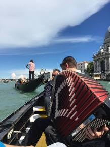 Accordion player and singer behind him taking a break