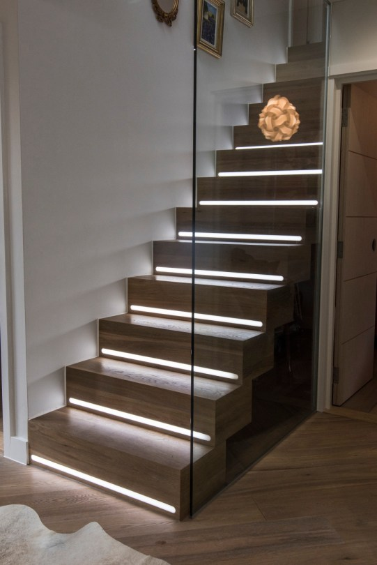 Handmade staircase with glass panel