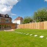 Timber frame extension, landscaped garden