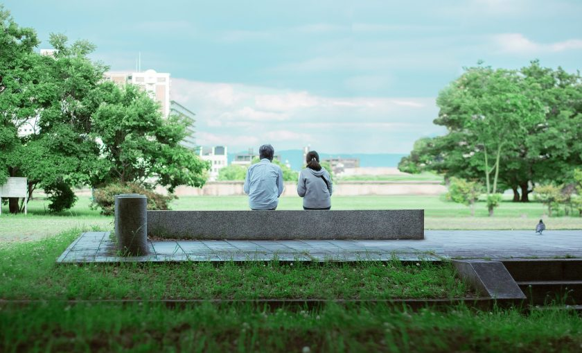 Man and woman sitting on a bench.