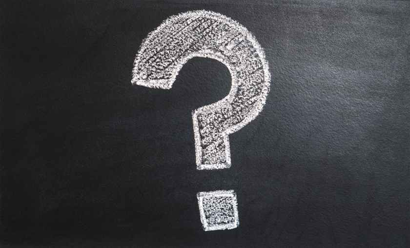 Question mark written on chalk