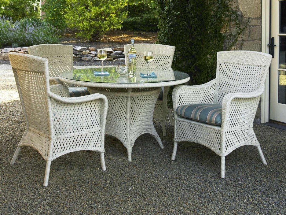 white wicker chairs and table big folding dining