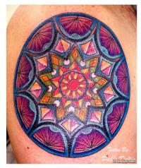 Many mandala tattoo designs resemble the colorful patterns ...