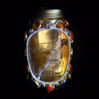 Bone of Saint in gold reliquary jar