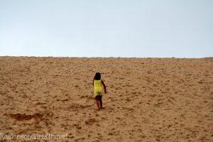 A Child Climbing Up the Dune Climb