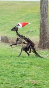 Metal dinosaur statue decorated for the holidays at Dinosaur Farm in Coloma, Michigan