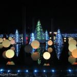 Center pond with balls & trees decoarated with lights at Garden Glow at Missouri Botanical Gardens