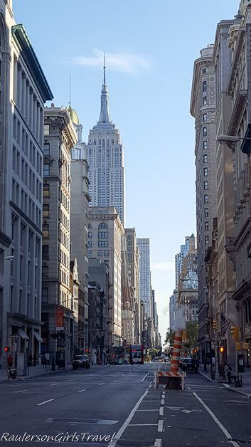 Looking down a New York street with the Empire State Building in the background
