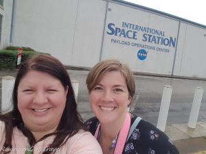 Heather Raulerson and Leslie Gibbs in front of International Space Station Payload Operations Center building
