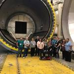 Pre-BEX tour group in front of Autoclave in Advanced Manufacturing Center