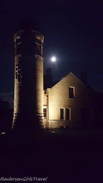 Old Mackinac Point Lighthouse at night with moon